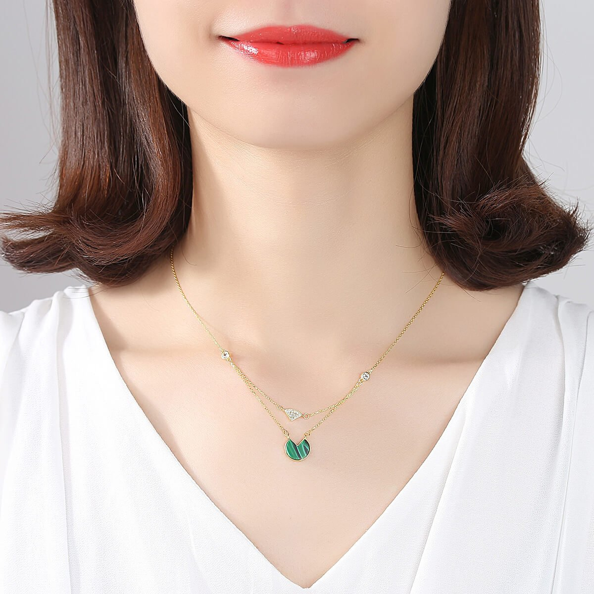 Model wears Sterling silver clavicle necklace for ladies with malachite